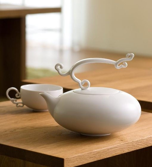 white teapot and cup set